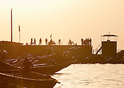 A crowded dock on the Niger River early in the morning at Segou, Mali