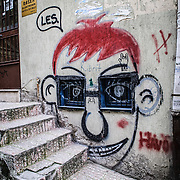 Graffiti in the Beyoglu district of Istanbul, Turkey. The face uses the existing windows as sunglasses.