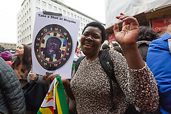 © Licensed to London News Pictures. 18/11/2017. London, UK. Zimbabweans dance and celebrate outside the Zimbabwe Embassy in London to demonstrate in support of the ousting of President Robert Mugabe. Photo credit: Vickie Flores/LNP
