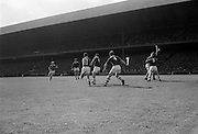 04/09/1966<br /> 09/04/1966<br /> 4 September 1966<br /> All-Ireland Senior Hurling Final: Kilkenny v Cork at Croke Park, Dublin.<br /> Cork defenders, P. Doolan (center) and goalie, P. Barry (1) clear in fromt of their own goalmouth.