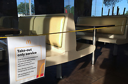March 18, 2020, Titusville, Florida, USA: A dining room at a McDonald's in Titusville, Florida is seen roped off as restaurants across the United States begin to temporarily close dining rooms in favor of take-out and drive thru options in an effort to contain the spread of the coronavirus. (Credit Image: © Paul Hennessy/SOPA Images via ZUMA Wire)