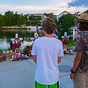 Mourners are seen at various memorial sites for the victims of a mass shooting at the Pulse nightclub, on June 26, 2016, in Orlando, Fla. A gunman killed dozens of people in a massacre at the crowded gay nightclub in Orlando, making it the deadliest mass shooting in modern U.S. history. (Alex Menendez)