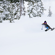 Owen Dudley makes some high speed powder turns on Mount Herman in the Mount Baker backcountry.