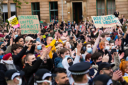 Glasgow, Scotland, UK. 13 May 2021.At approx 5.30 pm police released two men from a Home Office detention vehicle. Accompanied by lawyer Aamer Anwar the men walked to a nearby mosque surrounded by hundreds of police and supporters who had previously been surrounding the vehicle and sitting on the street.. Iain Masterton/Alamy Live News