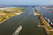 Nederland, Zuid-Holland, Nieuwe Waterweg, 23-05-2011; Maeslantkering in de Nieuwe Waterweg, gezien naar Rotterdam. De stormvloedkering bestaat uit twee deuren die klaar liggen in een dok en welke sluiten bij een waterstand van 3 meter of meer boven NAP. De kering, laatst voltooide onderdeel van Deltawerken, beschermt Rotterdam en achterland bij extreme waterstanden..The new storm surge barrier (Maeslantkering) in the Nieuwe Waterweg (New Waterway), the entrance to the port of Rotterdam (at the horizon)..In case of storm floods, the two enormous doors will close of the waterway protecting Rotterdam and its hinterland.luchtfoto (toeslag); aerial photo (additional fee required).foto Siebe Swart / photo Siebe Swart