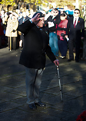 © Licensed to London News Pictures. 11/11/2012..Saltburn, Cleveland, England..The Remembrance Day parade and service takes place in the Cleveland seaside town of Saltburn by the Sea..A former serviceman salutes after laying a wreath at the memorial...Photo credit : Ian Forsyth/LNP
