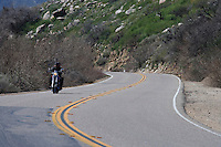 A motorcyclist navigtates an S-curve in Anza-Borrego Desert State Park, California