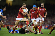 Hallam Amos of Wales powers his way through the Uruguay defence. .Rugby World Cup 2015 pool A match, Wales v Uruguay at the Millennium Stadium in Cardiff, South Wales  on Sunday 20th September 2015.<br /> pic by  Andrew Orchard, Andrew Orchard sports photography.