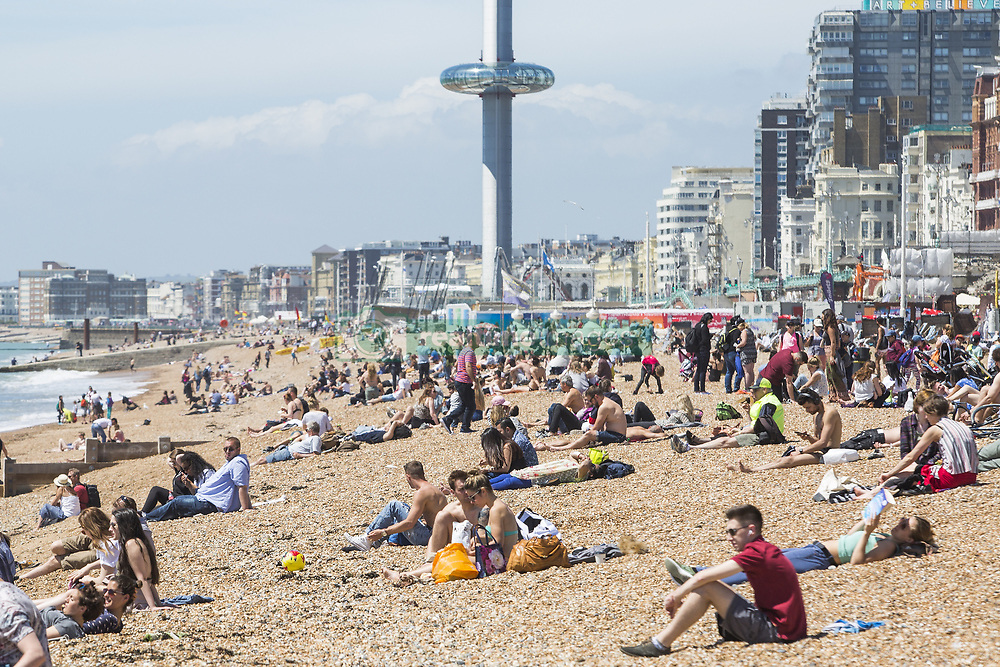 June 13, 2017 - Brighton, East Sussex, United Kingdom - Brighton, UK. Members of the public take advantage of the warm and sunny weather to sunbath on the beach in Brighton and Hove. (Credit Image: © Hugo Michiels/London News Pictures via ZUMA Wire)