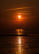 Walking the flats at sunset on Crosby Landing Beach.