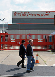"© Licensed to London News Pictures. 26/04/2013.Coca cola job cuts across the UK. Local people walk past the Sidcup site..Jobs could go at the Coca-Cola plant in Sidcup after the company announced nearly 300 positions in the UK are at risk..The Cray Road factory has been in business for more than 50 years and currently has 344 employees and seven manufacturing lines..Coca-Cola Enterprises (CCE) is planning to end its direct delivery service primarily used by restaurants..A CCE statement said: ""We have now started a full consultation on these proposals with our employee representative bodies and the Unite trade union..  The soft drinks giant has announced 288 jobs could go from a total work force of 4,400 across sites including Bristol, East Kilbride, Edmonton, Northampton and Wakefield and Sidcup... Photo credit :Grant Falvey/LNP"