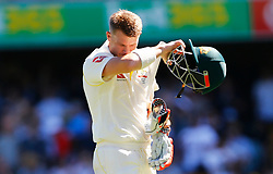 Australia's David Warner walks off after being dismissed during day two of the Ashes Test match at The Gabba, Brisbane.