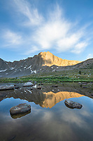 Dragon Head Peak reflected in pond near Lee Lake, Bridger Wilderness. Wind River Range, Wyoming