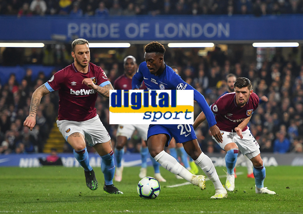 Football - 2018 / 2019 Premier League - Chelsea vs. West Ham United<br /> <br /> Chelsea's Callum Hudson-Odoi holds off the challenge from West Ham United's Marko Arnautovic and Aaron Cresswell, at Stamford Bridge.<br /> <br /> COLORSPORT/ASHLEY WESTERN