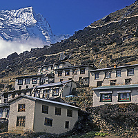 NEPAL, HIMALAYA. 6011 meter Kwangde Ri & houses in Namche Bazaar, leading town of Sherpas, Khumbu Region. Much growth has occured since this photo was taken in 1986.