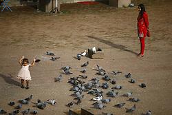 August 1, 2017 - Kathmandu, Nepal - A woman looks on as a child reacts to pigeons inside Boudhanath Stupa, a UNESCO World heritage site in Kathmandu, Nepal on Tuesday, August 01, 2017. (Credit Image: © Skanda Gautam via ZUMA Wire)