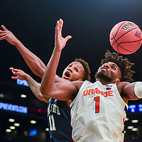 Syracuse forward Quincy Guerrier (1) rebounds over Penn State forward Lamar Stevens (11) during a game against Syracuse on Friday, Nov. 29, 2019, in the NIT Season Tip-Off at the Barclays Center in New York. (Scott Trimble | strimble@syracuse.com) N. Scott Trimble | strimble@syracuse.com