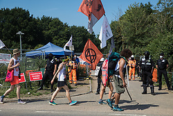 Activists from HS2 Rebellion and Extinction Rebellion UK pass a HS2 road closure as they take part in a 'Rebel Trail' hike along the route of the HS2 high-speed rail link on 26th June 2020 in Harefield, United Kingdom. The activists, who departed from Birmingham on 20th June and will arrive outside Parliament in London on 27th June, are protesting against the environmental impact of the high-speed rail link and questioning the viability of the £100bn+ project.