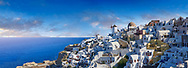 Panoramic view of traditional blue domed Greek Orthodox church of Oia, Island of Thira, Santorini, Greece. .<br /> <br /> If you prefer to buy from our ALAMY PHOTO LIBRARY  Collection visit : https://www.alamy.com/portfolio/paul-williams-funkystock/santorini-greece.html<br /> <br /> Visit our PHOTO COLLECTIONS OF GREECE for more photos to download or buy as wall art prints https://funkystock.photoshelter.com/gallery-collection/Pictures-Images-of-Greece-Photos-of-Greek-Historic-Landmark-Sites/C0000w6e8OkknEb8