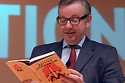 """© Licensed to London News Pictures. 17/11/2012. London, UK Michael Gove reads aloud from the book """"The Lost World of British Communism"""" Education Secretary Michael Gove (right) in conversation with journalist David Aaronovitch at the London Festival of Education today, 17th November 2012. Mr Gove took part in a lively question and answer session and was booed by some of the audience on arrival to stage. Photo credit : Stephen Simpson/LNP"""