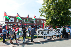 © Licensed to London News Pictures. 06/07/2017. Shenstone, Staffordshire, UK. On the second anniversary of Israel's brutal assault on Gaza in July 2014  in which 2,200 Palestinians were killed, including more than 550 children, campaigners from across the UK travel to Elbit's factory in Shenstone, Lichfield in Staffordshire for a non-violent picket outside the factory gates to demand that the UK stops arming Israel and that Elbit's factory ceases their production of death drones. Elbit's death drones are used by The Israel Defence Force against the people of Palestine. Photo credit: Graham M. Lawrence/LNP