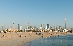View of modern skyline of Dubai from Jumeirah Open Beach in United Arab Emirates UAE