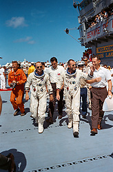 Aug 29, 2017 - USS Lake Champlain - Gemini V command pilot GORDON COOPER (right) and CHARLES 'PETE' CONRAD, pilot, walk across the deck of the aircraft carrier USS Lake Champlain following their spacecraft's recovery from the ocean on Aug. 29, 1965. The eight-day Gemini V endurance mission doubled America's spaceflight record set two months earlier. It also tested technology that would help make longer missions possible, allowing astronauts to meet the challenges for landing on the moon and laying the groundwork for long-duration missions aboard the International Space Station. (Credit Image: © NASA/ZUMA Wire/ZUMAPRESS.com)