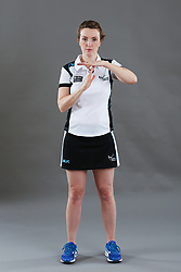 Umpire Louise Travis signalling hold time