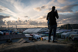 October 22, 2016 - Calais, France - View of the jungle from the an hill in the middle of the camp. Calais France, on 22 October 2016.  As the date of the eviction gets closer, the migrants and refugees of jungle are thinking about their options. Some have decided to to leave the camp before the start of the dismantling, others are willing to stay in France and therefore to follow with the plan of entering a center. (Credit Image: © Guillaume Pinon/NurPhoto via ZUMA Press)