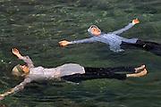 Muslim girls floating in the sea Beirut