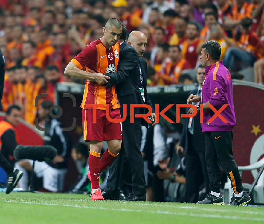 Galatasaray's Burak Yilmaz (L) and Coach Hamza Hamzaoglu (R) during their Turkish Super League derby match Galatasaray between Besiktas at the AliSamiYen Spor Kompleksi TT Arena at Seyrantepe in Istanbul Turkey on Sunday, 24 May 2015. Photo by Aykut AKICI/TURKPIX