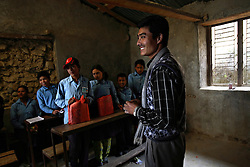 Chakraman Shreshta Balami, 28, teaches at the one school inside Kagati Village, Kathmandu Valley, Nepal on Jan. 31 ,2007.  Although the uncle of a recent child bride, Chakraman has worked for years with a group of other men in the village to stop the practice. The Kagati village, a Newar community, is most well known for its propensity towards child marriage. Many Hindu families believe blessings will come upon them if marry off their girls before their first menstruation.