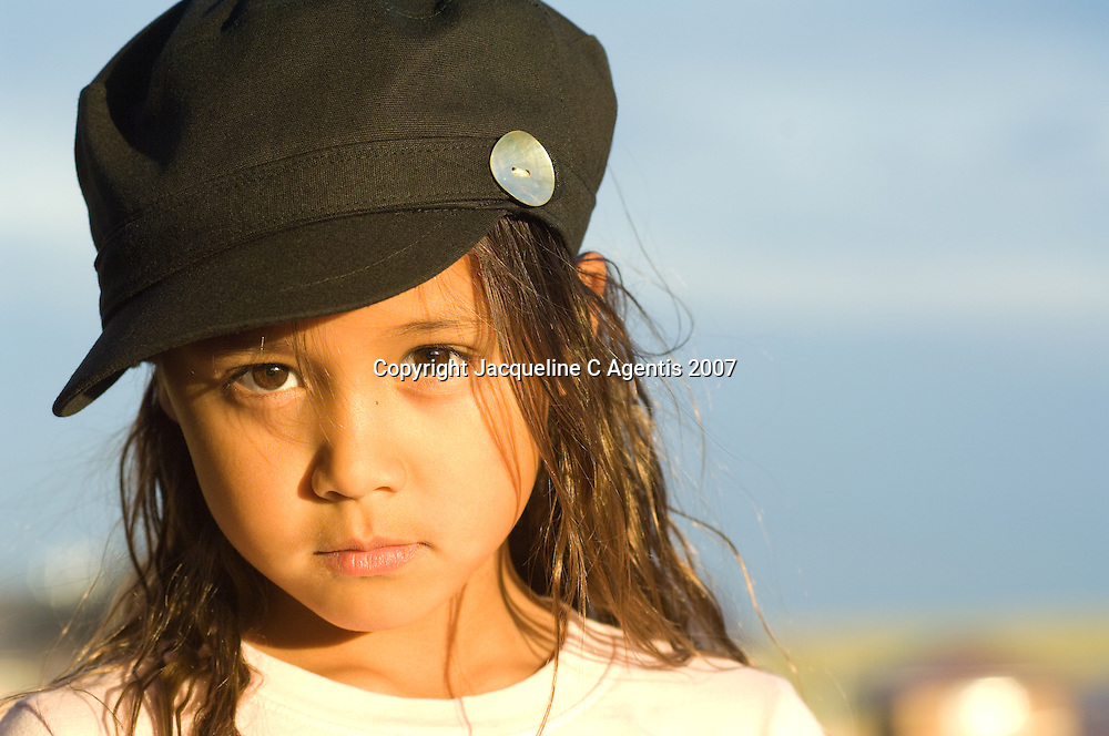 7 year old Asian Girl looking Intensely into the Camera. Canon City, Colorado June 2007