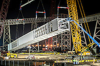 The CCC Group team prepares to lift a 300-ft. long conveyer truss across La. Hwy 44 at the Ormet site in Ascension Parish, Louisiana.