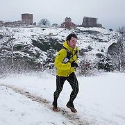 A runner comes up from the forest below with Hammers Hus castle in the back ground. Salomon Hammer Trail Winter Edition is a first on Bornholm and is one of the toughest routes in Denmark. The 4 runs consist of a 50 mile run, a marathon, a 1/2 marathon and 10k all run a on an approximate 25km route which includes 860 meter vertical rise on the North East coast of the Danish island Bornholm. The cut-off time for the 50mile run was 16 hours and more than a hundred runners made it to the finishing line. The last runner across the line after 50 miles  was in after 15:14:40