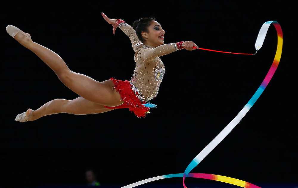 England's Mimi Isabella Cesar performs with the ribbon during women's rhythmic gymnastics team competition at the Commonwealth Games in Glasgow, Scotland, July 24, 2014.   REUTERS/Jim Young