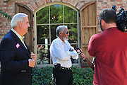 Bill Luckett, left., watches as his friend and business partner oscar winning actor Morgan Freeman speaks to the media regarding his endorsement of Bill Luckett for Democrayic candidate for Governor of Mississippi. the Luckett for Governor campaign duringa fund raiser in Madison MS. Sunday Oct. 17,2010.Photo©Suzi Altman