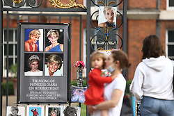 © Licensed to London News Pictures. 02/07/2021. London, UK. Floral tributes and pictures of Diana, Princess of Wales, remain at the entrance to Kensington Palace where a statue of Princess Diana was unveiled by Prince William and Prince Harry yesterday afternoon. Photo credit: Ben Cawthra/LNP