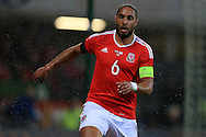 Ashley Williams of Wales looks on.  Wales v Northern Ireland, International football friendly match at the Cardiff City Stadium in Cardiff, South Wales on Thursday 24th March 2016. The teams are preparing for this summer's Euro 2016 tournament.     pic by  Andrew Orchard, Andrew Orchard sports photography.