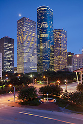 Downtown Houston, Texas cityscape at night featuring One Shell Plaza, Wells Fargo Plaza, Enterprise Plaza, and City Hall.