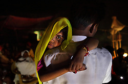 Rajni, 5, was woken up at 4 am and carried by her uncle to be married in a secret wedding ceremony. Three young sisters Radha, 15, Gora, 13, and Rajni, 5, were married to three young grooms, who were also siblings, on the Hindu holy day of Akshaya Tritiya in North India.
