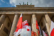 01/05/2015 – Berlin, Germany: Flags of the DGB, the Confederation of German Trade Unions pass under the Brandenburg gate during a demonstration called by DGB to celebrate the International Workers Day. The International Workers Day is a celebration of laborers and the working classes that is promoted by the international labor movement, anarchists, socialists, and communists and occurs every year on May Day. (Eduardo Leal)
