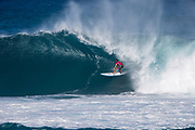 Dion Atkinson of Australia advances to round two by placing first in round one heat 4 of the 2017 WSL Vans World Cup at Sunset Beach, Oahu