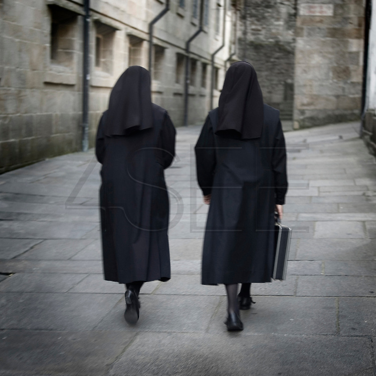 Two nuns in Santiago de Compostela, Galica . Spain . The WAY OF SAINT JAMES or CAMINO DE SANTIAGO following the French Route, between Saint Jean Pied de Port and Santiago de Compostela in Galicia, SPAIN. Tradition says that the body and head of St. James, after his execution circa. 44 AD, was taken by boat from Jerusalem to Santiago de Compostela. The Cathedral built to keep the remains has long been regarded as important as Rome and Jerusalem in terms of Christian religious significance, a site worthy to be a pilgrimage destination for over a thousand years. In addition to people undertaking a religious pilgrimage, there are many travellers and hikers who nowadays walk the route for non-religious reasons: travel, sport, or simply the challenge of weeks of walking in a foreign land. In Spain there are many different paths to reach Santiago. The three main ones are the French, the Silver and the Coastal or Northern Way. The pilgrimage was named one of UNESCO's World Heritage Sites in 1993. When there is a Holy Compostellan Year (whenever July 25 falls on a Sunday; the next will be 2010) the Galician government's Xacobeo tourism campaign is unleashed once more. Last Compostellan year was 2004 and the number of pilgrims increased to almost 200.000 people.