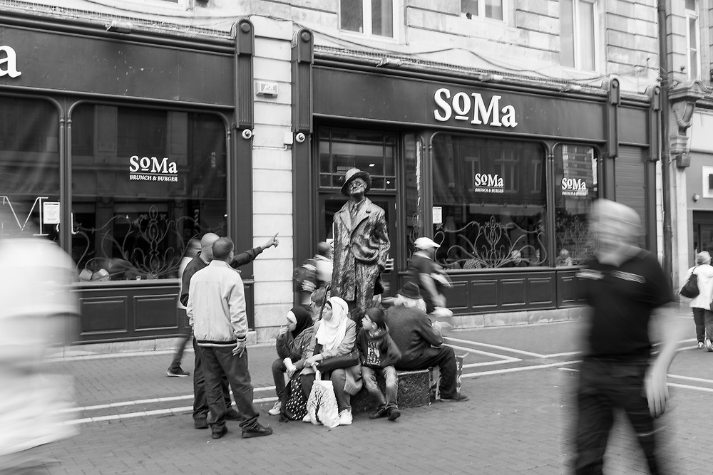 Resting at the James Joyce statue on North Earl Street, Dublin, Ireland.