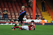Jonathan Williams of Crystal Palace is tackled by Bristol City's Greg Cunningham. Capital one cup match, 2nd round, Bristol city v Crystal Palace at Ashton Gate stadium in Bristol on Tuesday 27th August 2013. pic by Andrew Orchard , Andrew Orchard sports photography,