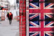 Union Jack flags outside a shop on Oxford Street which is mainly empty of shoppers as the national coronavirus lockdown three continues on 28th January 2021 in London, United Kingdom. Following the surge in cases over the Winter including a new UK variant of Covid-19, this nationwide lockdown advises all citizens to follow the message to stay at home, protect the NHS and save lives.