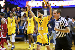 Feb 2, 2019; Morgantown, WV, USA; West Virginia Mountaineers forward Esa Ahmad (23) celebrates after beating the Oklahoma Sooners at WVU Coliseum. Mandatory Credit: Ben Queen-USA TODAY Sports
