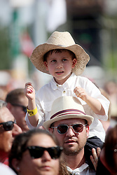 29 April 2012. New Orleans, Louisiana,  USA. <br /> New Orleans Jazz and Heritage Festival. <br /> A youngster in the crowd enjoys the music.<br /> Photo; Charlie Varley/varleypix.com