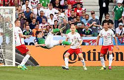 Kyle Lafferty of Northern Ireland attempt an over head kick  - Mandatory by-line: Joe Meredith/JMP - 12/06/2016 - FOOTBALL - Stade de Nice - Nice, France - Poland v Northern Ireland - UEFA European Championship Group C